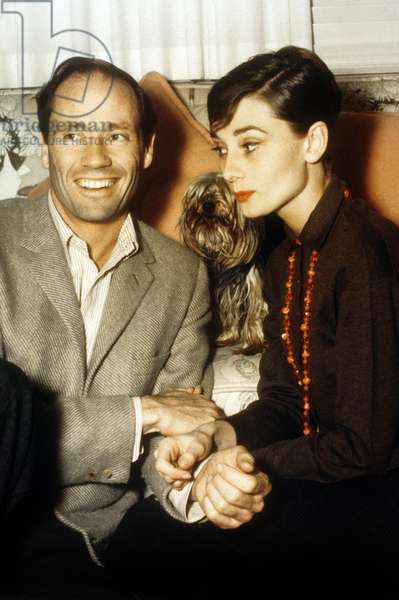 American Actor Mel Ferrer (Melchior Gaston Ferrer, 1917 - 2008) and British Actress Audrey Hepburn (Edda Audrey Kathleen Ruston, 1929 - 1993) with a dog, a Yorkshire called Famous.