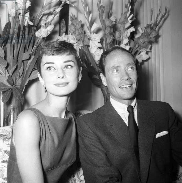 Audrey Hepburn and husband Mel Ferrer at press conference during honeymoon