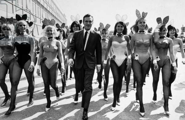 Hugh Hefner, press magnate, director of magazine Playboy with his bunnies at London airport in June 1966