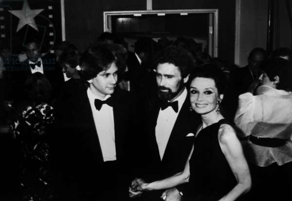 Audrey Hepburn with her son Sean Ferrer Ferrer and Robert Wolders at American Film Institute party in Hollywood , April 1981