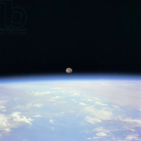 Moon Set over the Earth limb taken from Space Shuttle Discovery during STS-70 July 1995