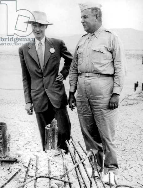 Robert Oppenheimer and Major General Leslie Groves inspecting the new atomic-bomb test site in New Mexico, 1942 (b/w photo)