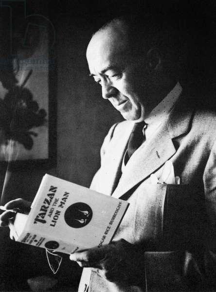 Edgar Rice Burroughs (1875-1950) American novelist creator of Tarzan here with book Tarzan and the lion man, 1934