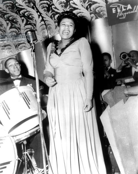 Ella Fitzgerald (1917-1996) American jazz Singer here with drummer Bill Beason and trumpeters Dick Vance and Irving Randolph, at the Savoy Ballroom in New York 1941