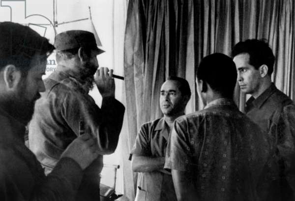 Fidel Castro, head of cuban state, meeting Mehdi Ben Barka, founder of national union of popular forces in Morocco, in Cuba c. 1964