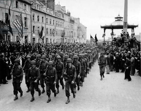 Cherbourg, Normandy, France, July 14, 1944 : parade of American soldiers