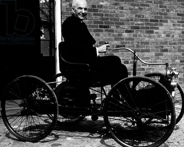 Henry Ford (1863-1947) in his first car Quadricyle built in 1896