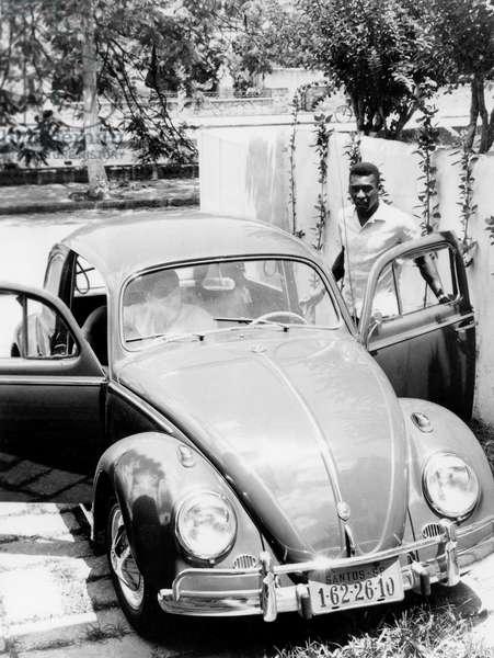 Brazilian soccer Edson Arantes do Nascimento aka pele and his car (Volkswagen beetle) in Santos December 1964