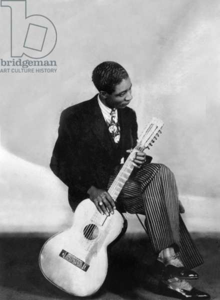 Blues guitarist Lonnie Johnson and Johnson in 1929