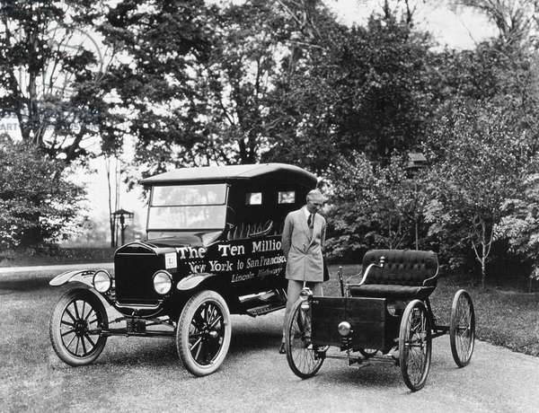 Henry Ford (1863-1947) American industrialist pioneer of American car industry here near a Ford T (ten million built) and looking his 1st car, 1924