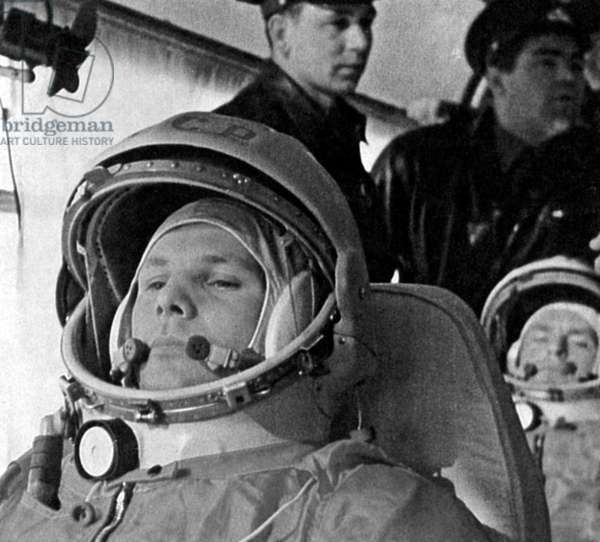 A pensive Yuri Gagarin is in the bus on the way to the launch pad on the morning of April 12, 1961. Behind him, seated, is his backup, German Titov. Standing are cosmonauts Grigoriy Nelyubov and Andrian Nikolayev