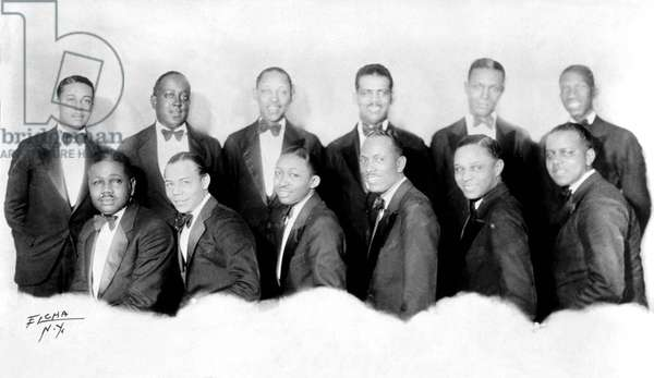 Andy Kirk and his jazz band Twelve Clouds Of Joy in 1929 Standing l-r : John Harrington, Mac Neal, Allen Durham, Harry Lawson, Jean Prince, John O. Williams ; Seated l-r : Marion Jackson, Billy Massey, Claude Williams, Andy Kirk, Bill Dirvin, Lawrence Freeman