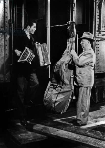 Strangers on a Train, directed by  Alfred Hitchcock starring Farley Granger with Hitchcock making a cameo appearance, 1951