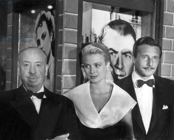 Alfred Hitchcock, Grace Kelly and Oleg Cassini at premiere of film REAR WINDOW, Hollywood Paramount, August 12, 1954