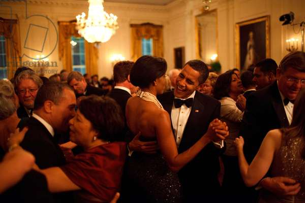 President Barack Obama and First Lady Michelle Obama dance while the band Earth, Wind and Fire performs at the Governors Ball in the State Dining Room of the White House fevruary 22, 2009