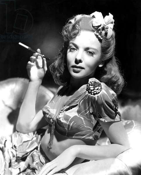 Ida Lupino smoking with cigarette holder c. 1947
