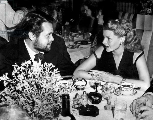 Orson Welles and his 3rd wife Rita Hayworth at restaurant c. 1944