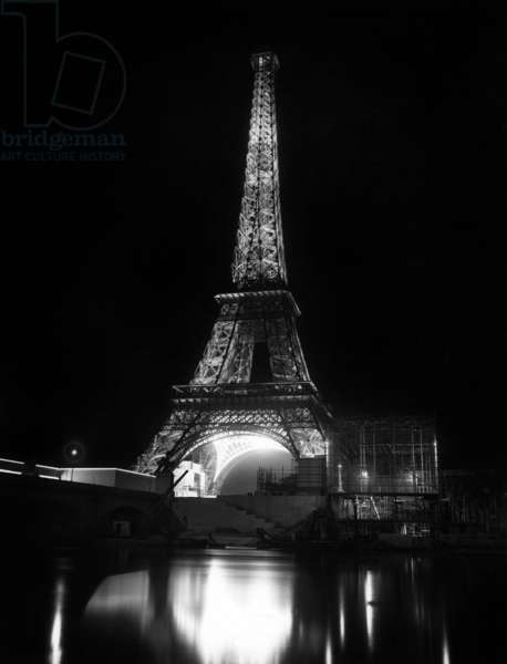 The Eiffel Tower by night at time of set-up of wrold fair in Paris, 1937