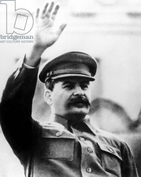 Josef Stalin (1879 - 1953) communist leader of sovietique union from 1926 to 1953, saluting with hand, c. 1943
