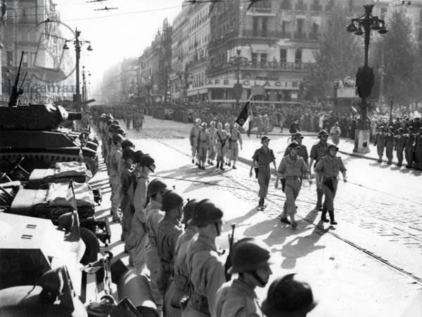 On the Canebiere in Marseille, France : parade of troops after liberation of the town, August 29, 1944