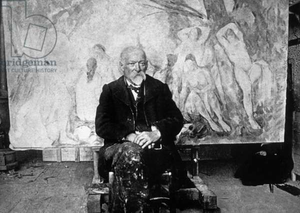 Paul Cezanne (1839-1906) French painter in 1904 in front of one of his canvas showing swimmers, photo by Emile Bernard