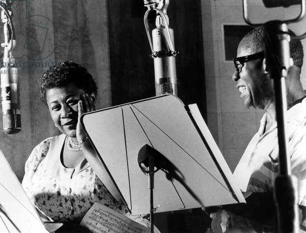 Ella Fitzgerald (1917-1996) American jazz Singer with Louis Armstrong (1900-1971) jazz trumpet player and Singer during a recording at Decca Records New York 1950