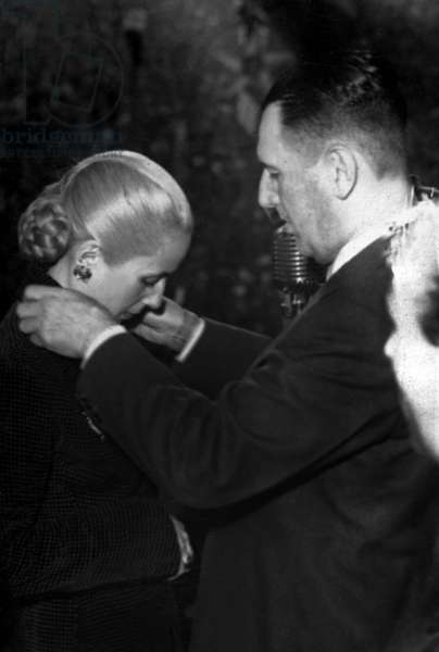 Juan Domingo Peron (1895-1974) argentinian President giving award to his wife Eva on October 1951
