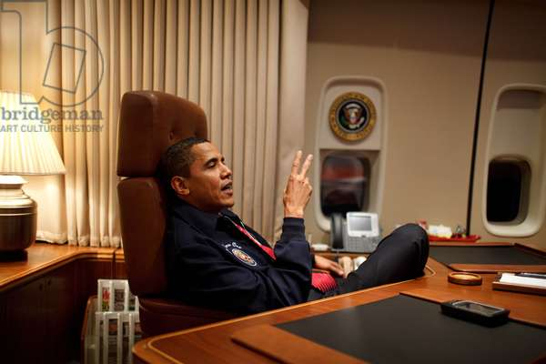 President Barack Obama wears a AF1 jacket on his first flight aboard Air Force One from Andrews Air Force Base to Newport News February 5, 2009