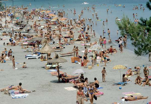 People at the beach of Palma Nova in Mallorca in Baleares (Spain) in July 1978