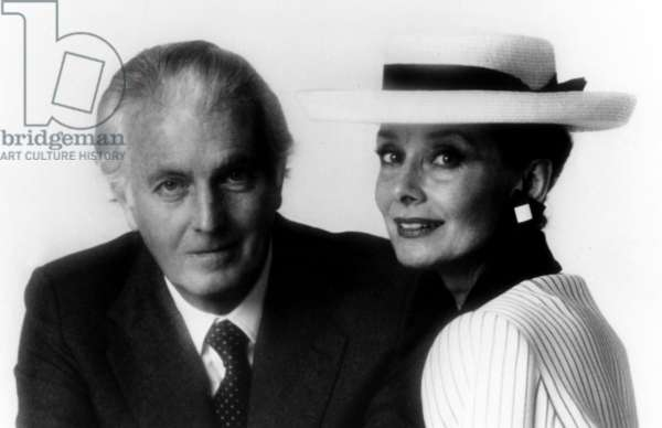 Hubert de Givenchy with Actress Audrey Hepburn one of the admirers of his fashion, together in one of his shops in 1983