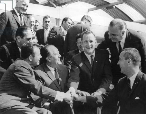 Soviet cosmonaut Yuri Gagarin shakes hand with NASA's Gemini 4 Astronauts (Gemini project), Edward H. White II and James A. McDivitt at the Paris International Air Show in June 19, 1965. On r French President Georges Pompidou