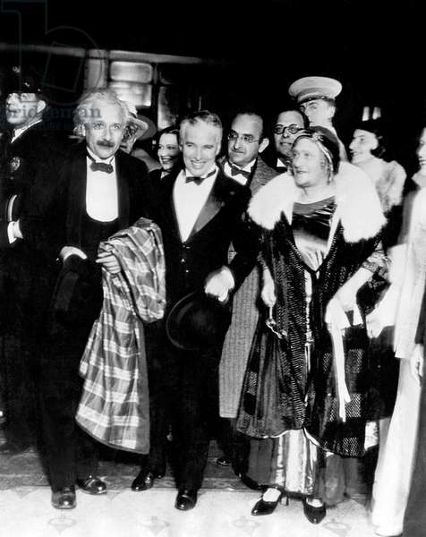 The swiss theoretical physicist of German origin Albert Einstein (1879-1955) and his 2nd wife Elsa Lowenthal (r) with the swiss and English director and Actor, Charlie Chaplin at premiere of film City Lights at the Los Angeles theater January 30, 1931