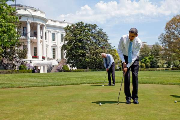President Barack Obama and Vice President Joe Biden practice their putting on the White House putting green April 24, 2009