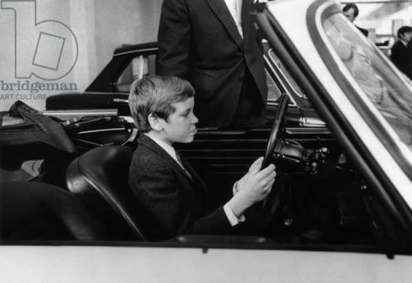 Prince Albert of Monaco (b1958, son of prince RainierdeMonaco and PrincessGrace, future Albert II) here driving a car given by his father, April 11, 1969