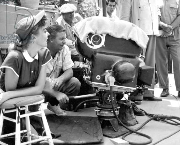 Ida Lupino (1914-1995) directing with assistant cameraman Emmett Berkholtz on set of film