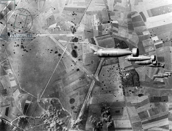 View of bombs dropping from American B17 flying fortress : Allied bombings on German occupied airport in Abbeville August 19, 1942