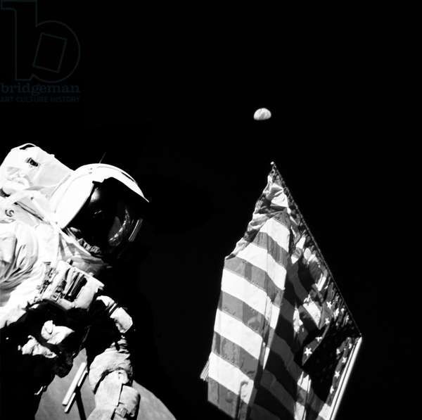 Geologist-Astronaut Harrison Schmitt, Apollo 17 Lunar Module pilot, is photographed next to the American Flag during extravehicular activity (EVA) of NASA's final lunar landing mission in the Apollo series. The photo was taken at the Taurus-Littrow landing site, December 13, 1972