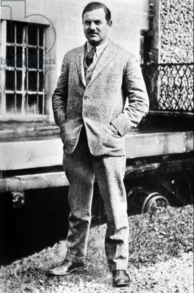 Novelist Ernest Hemingway outside the house he lived with Hadley Richardson in Paris, rue Notre-Dame-des-Champs, 1924