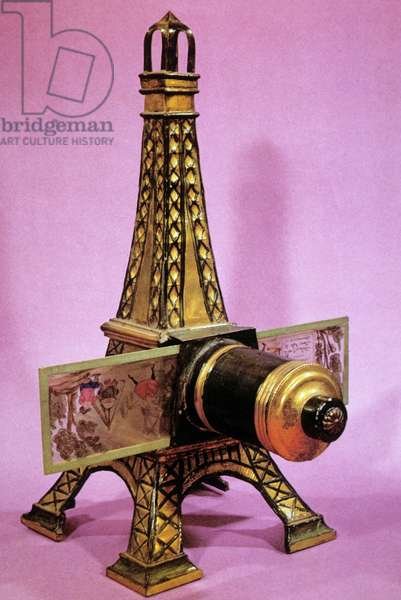Model of magic lantern (invented in 18th century) here as Eiffel tower