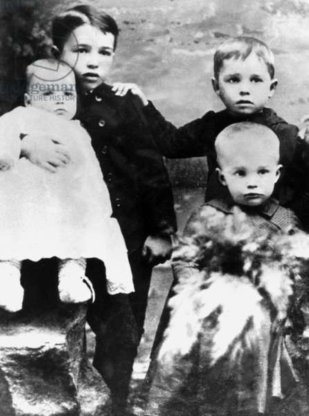 young child Dwight Eisenhower (2 year-old child, corner right) here with his brothers Edgar and Roy in 1892