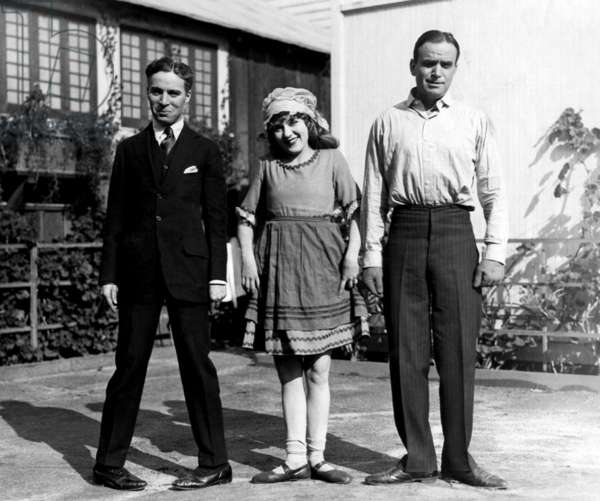 Charlie Chaplin, Mary Pickford and her husband Douglas Fairbanks Sr gagging it up on a studio lot, 1921
