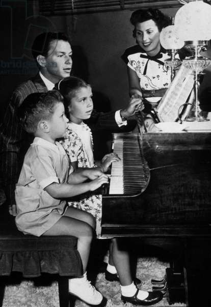 Frank Sinatra with his wife Nancy and their children Nancy and Frank Jr at the piano c. 1948