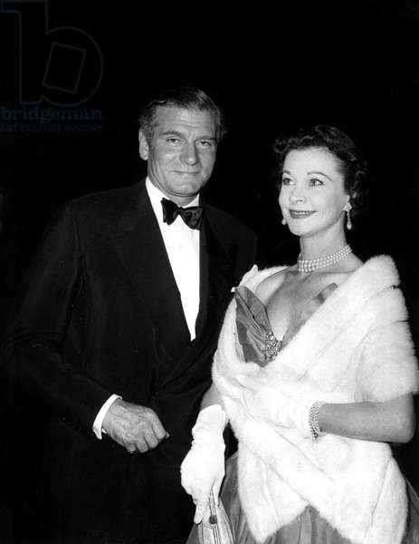 Actors Laurence Olivier and his wife Vivien Leigh attending the party Welcome to Britain at Ambassadeurs club in London on October 8, 1956