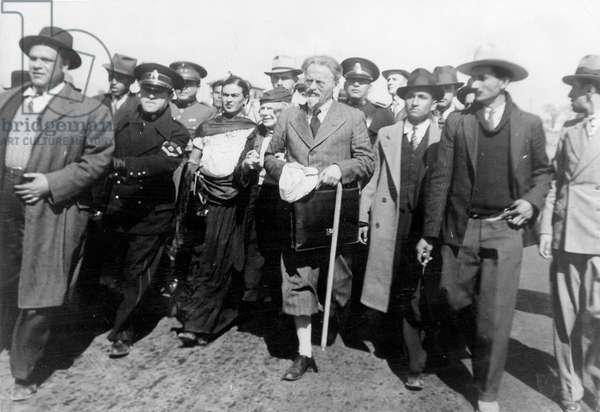 Leo Trotsky and his wife Natalia (Frida Kahlo on her r) arriving in Mexico, protected by policemen January 1937