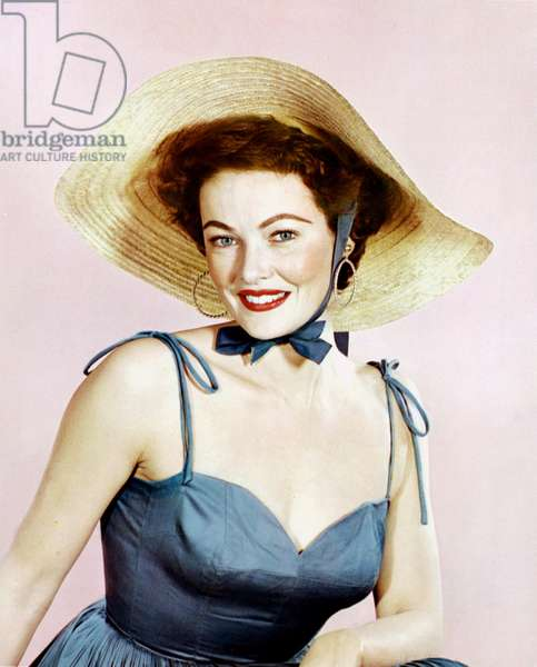 American Actress Gene Tierney (1920-1991) with a straw hat c. 1947