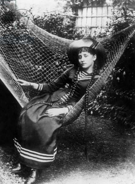 French writer Colette (1873-1954) in garden at 15 years old in 1888 in hammock