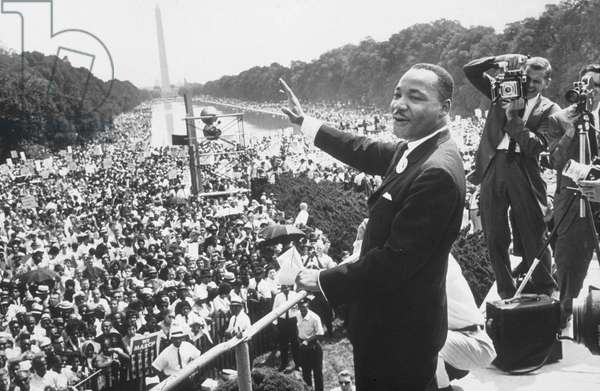 Martin Luther King  (1929-1968) American priest activist for Civil Right Movement of black Americans saluting the crowd during the March in Washington on August 28, 1963