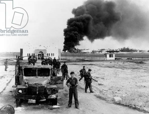 First picture of allied troops in Port Said during Suez crisis burned Egyptian lorry oil in fire November 9, 1956