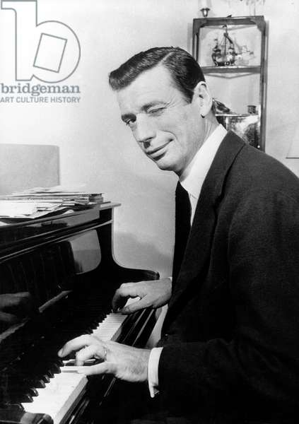 Yves Montand Playing The Piano in 1957 (b/w photo)