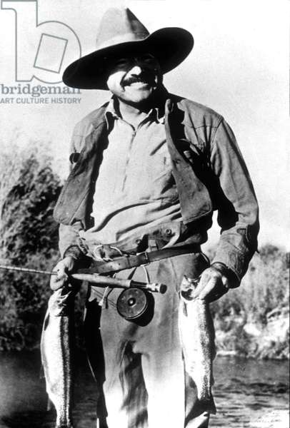 Ernest Hemingway (1899-1961) American writer fishing in Wood River Sun Valley (Idaho) in 1939